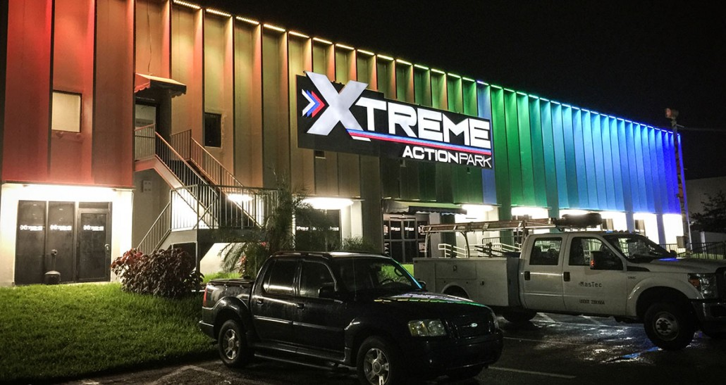 xtreme action park family entertainment center exterior signage design night light